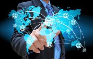 photodune-2505629-businessman-hand-pushing-social-network-on-world-map-sized