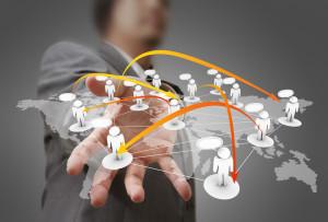 photodune-1118912-businessman-hand-holds-social-network-s (1)